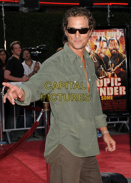 "MATTHEW McCONAUGHEY.""Tropic Thunder"" Los Angeles Premiere at Mann's Village Theatre, Westwood, California, USA..August 11th, 2008.half hand pointing length green shirt sunglasses shades .CAP/ADM/BP.©Byron Purvis/AdMedia/Capital Pictures."