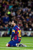 5th November 2019; Camp Nou, Barcelona, Catalonia, Spain; UEFA Champions League Football, Barcelona versus Slavia Prague; Lionel Messi sits in the pitch as his effort goes wide during round 4 of UEFA Champions League match against Slavia Praga - Editorial Use