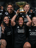 The Black Ferns celebrate winning the Laurie O'Reilly Memorial Trophy international women's rugby match between the New Zealand Black Ferns and Australia Wallaroos at Eden Park in Auckland, New Zealand on Saturday 25 August 2018. Photo: Simon Watts / lintottphoto.co.nz