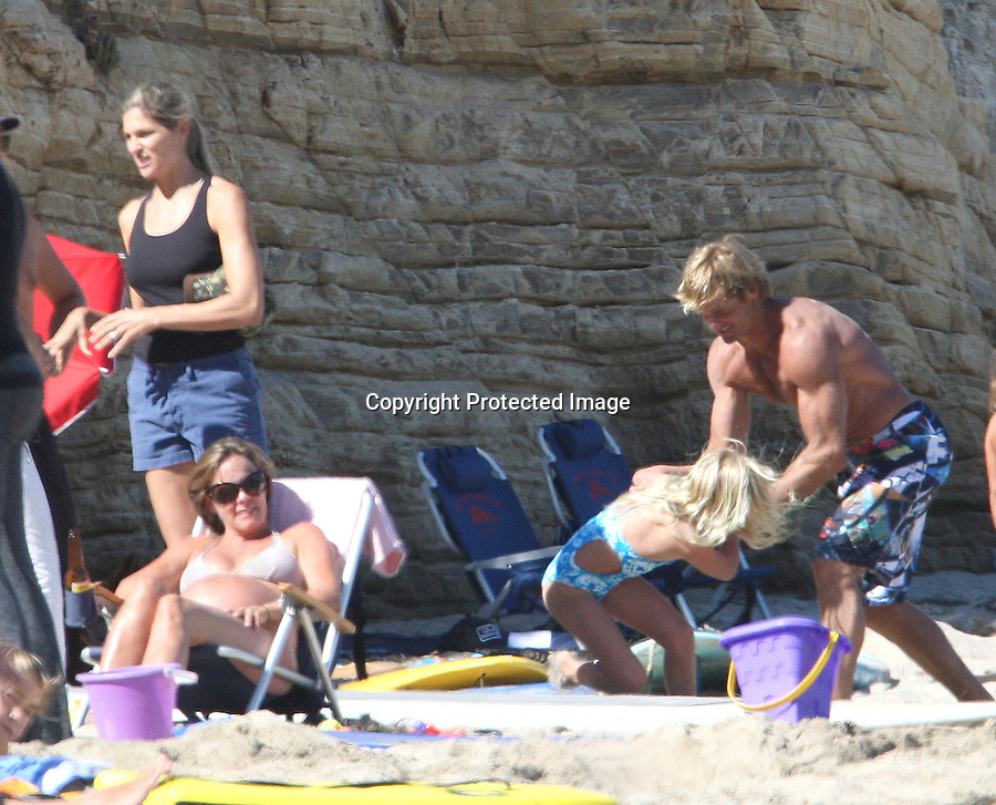 . August 15th   Sunday Exclusive ...Gabrielle Reece & husband Laird Hamilton playing with there kids on the beach in Malibu California. Gabrielle was wearing a blue bikini show off her big ass. Looks like she has a little Cellulite in her butt compared to her ripped husbands muscles & six pack abs ..AbilityFilms@yahoo.com.805-427-3519.www.AbilityFilms.com.