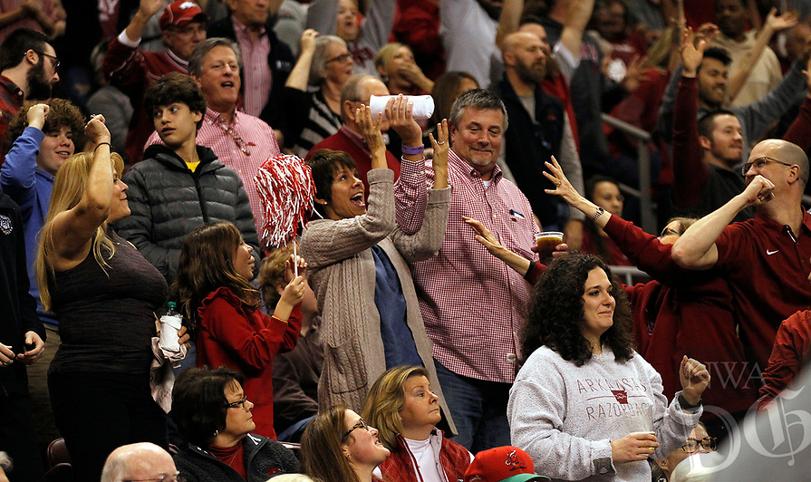Arkansas Democrat-Gazette/THOMAS METTHE -- 12/16/2018 --<br /> An Arkansas fan catches a t-shirt during a timeout in the first half of the Razorbacks' 79-67 win on Saturday, Dec. 15, 2018, at Verizon Arena in North Little Rock.