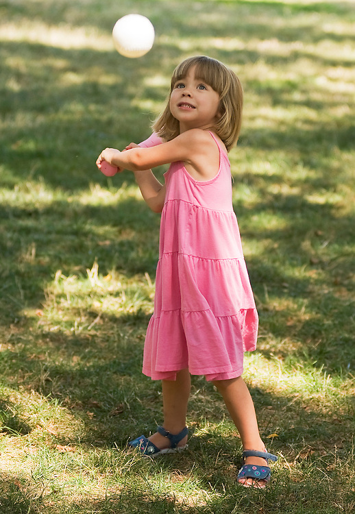 UNITED STATES - JULY 18:  A little girl from southwest Washington swings at a plastic ball, pitched by her mother, on the National Mall.  *Mother declined IDs  (Photo By Tom Williams/Roll Call)