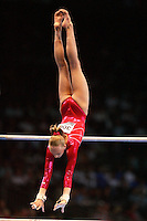 September 8, 2007; Stuttgart, Germany;  Anastasia Liukin of USA recatches on uneven bars during event finals in women's artistic gymnastics at 2007 World Championships.  Photo by Copyright 2007 by Tom Theobald.
