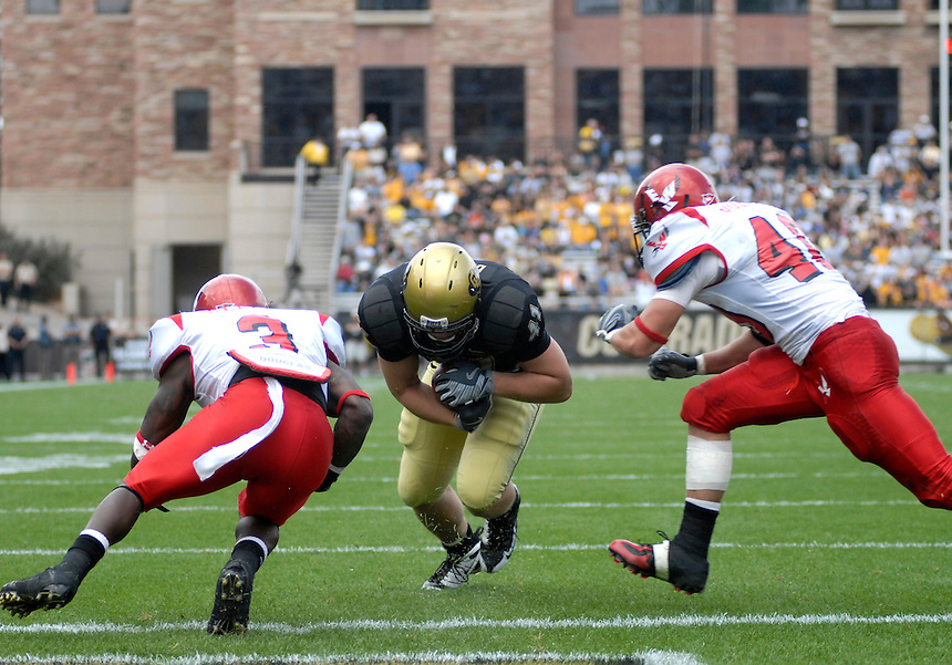 06 September 08: Colorado tight end Jake Behrens (41) dives between Eastern Washington defensemen for a touchdown. The Colorado Buffaloes defeated the Eastern Washington Eagles 31-24 at Folsom Field in Boulder, Colorado. FOR EDITORIAL USE ONLY