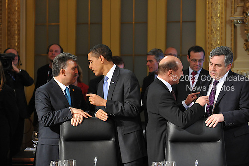 Baden-Baden, Germany - April 4, 2009 -- Heads of State and Government attend a Working Dinner at the NATO Summit in Baden-Baden, Germany on Saturday, April 4, 2009.  From left to right: Abdullah Gül, President of Turkey; Barack H. Obama, President of the United States of America; Traian Basescu, President of Romania and Gordon Brown, Prime Minister of the United Kingdom..Mandatory Credit: NATO via CNP
