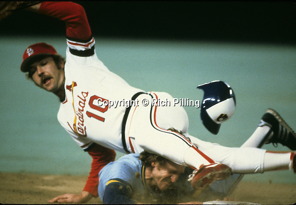 ST. LOUIS, MO - OCTOBER 1982: Infielder Robin Yount #19 of the Milwaukee Brewers slides head first under third baseman Ken Oberkfell #10 of the St. Louis Cardinals during the World Series at Bush Stadium in October 1982 in St. Louis, Missouri. Yount played for the Brewers from 1974-93. (Photo by Rich Pilling)