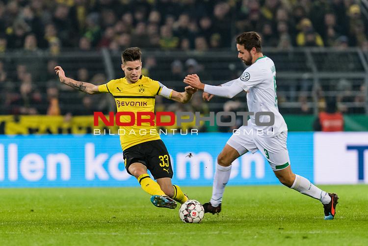 05.02.2019, Signal Iduna Park, Dortmund, GER, DFB-Pokal, Achtelfinale, Borussia Dortmund vs Werder Bremen<br /> <br /> DFB REGULATIONS PROHIBIT ANY USE OF PHOTOGRAPHS AS IMAGE SEQUENCES AND/OR QUASI-VIDEO.<br /> <br /> im Bild / picture shows<br /> Julian Weigl (Dortmund #33) im Duell / im Zweikampf mit Martin Harnik (Werder Bremen #09), <br /> <br /> Foto © nordphoto / Ewert