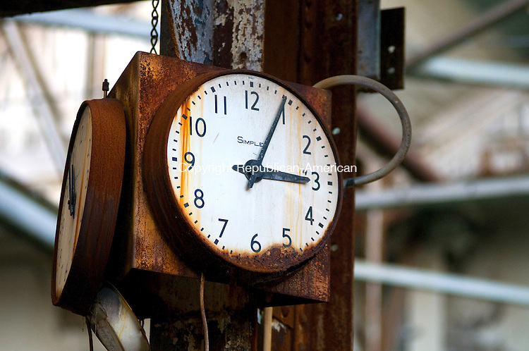 WATERBURY, CT-01062012--010612JS10--An old clock inside the old Waterbury Industrial Commons building on Thomaston Ave. in Waterbury. .Jim Shannon Republican-American