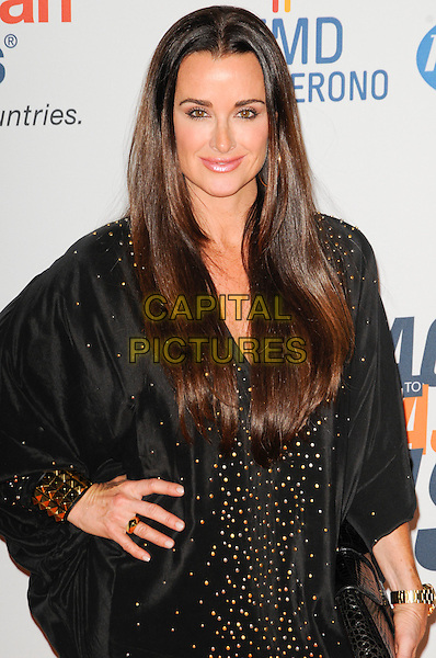 KYLE RICHARDS .The 17th Annual Race to Erase MS at the Hyatt Regency Century Plaza Hotel in Century City, California, USA..May 7th, 2010.half length black dress silver gold stud studded hand on hip.CAP/ROT.©Lee Roth/Capital Pictures