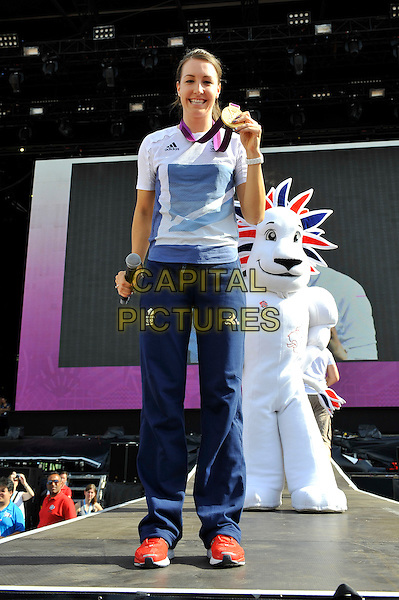 Dani King.Gold Medal Winner for Team GB, attending BT London Live, Hyde Park, London, England. .5th August 2012.cyclist full length white t-shirt blue tracksuit medal microphone athlete.CAP/MAR.© Martin Harris/Capital Pictures.