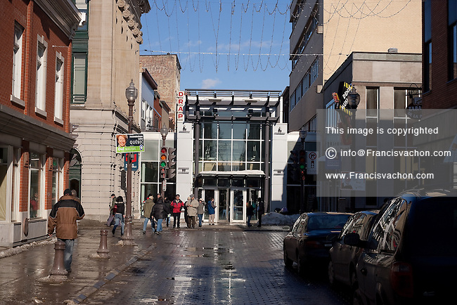 West entrance of the of the Mail St-Roch mall is pictured in Quebec city March 3, 2007 at St-Joseph street and rue Du Pont street crossroad, days before it is teared down to bring rue St-Joseph Street back to life. The removal of the roof on Saint-Joseph street allowed residents to rediscover 19th-century buildings and bring back shoppers and stores in this decaying street.