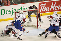 Jun 7, 2007; Hamilton, ON, CAN; Hershey Bears center (12) Alexandre Giroux fails to score on a wrap around attempt against the Hamilton Bulldogs in game five of the Calder Cup finals at Copps Coliseum. The Bulldogs defeated the Bears 2-1 to win the Calder Cup. Mandatory Credit: Ron Scheffler