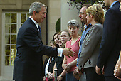 "Washington, D.C. - July 8, 2005 -- United States President George W. Bush shakes hands with people at the British Embassy after he laid a wreath in memory of those killed and injured during the bombing attack in London, England.  In earlier remarks the President stated: ""Yesterday was an incredibly sad day for a lot of families in London.  It's my honor, Ambassador, to come and represent our great country in extending our condolences to the -- to the people of Great Britain.  To those who suffer loss of life, we pray for God's blessings.  For those who are injured, we pray for fast healing.  The British people are steadfast and strong.  Long we've admired the great spirit of the -- of Londoners and the people of Great Britain.  Once again that great strength of character is coming through.""<br /> Credit: Dennis Brack - Pool via CNP"