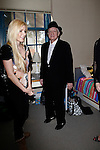 Crystal Harris and Hugh Hefner at a ceremony where Hugh Hefner receives first founder's 'Hero of the Hearts' award from Children of the Night on November 18, 2010 in Van Nuys, Los Angeles, California.