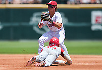 NWA Democrat-Gazette/CHARLIE KAIJO Arkansas infielder Casey Martin (15) slides to second base during the second game of the NCAA super regional baseball, Sunday, June 10, 2018 at Baum Stadium in Fayetteville. Arkansas fell to South Carolina 5-8.