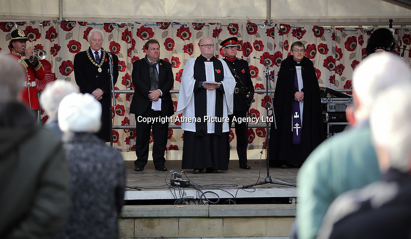 Pictured: Local dignitaries and priests lead the service Friday 11 November 2016<br />