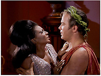 BNPS.co.uk (01202 558833)<br /> Pic: NBC/Paramount/PropStore<br /> <br /> Captain Kirk and Lt Uhura get to grips in the groundbreaking episode...<br /> <br /> Historic Star Trek toga in which Capt Kirk boldy went where no US TV series had gone before...<br /> <br /> The toga Captain Kirk wore while locking lips with Lieutenant Uhura in one of the first inter-racial kisses on television 50 years ago has emerged for sale for &pound;46,000 ($60,000)<br /> <br /> William Shatner was dressed in the maroon Grecian toga for the tender moment with Nichelle Nichols in the episode 'Plato's Stepchildren' filmed in 1968.<br /> <br /> The toga will go under the hammer alongside Mr Spock's green toga worn by Leonard Nimroy in the same episode, which is valued at &pound;23,000.