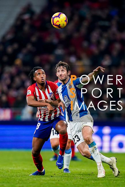 Esteban Felix Granero Molina of RCD Espanyol (R) fights for the ball with Gelson Martins of Atletico de Madrid during the La Liga 2018-19 match between Atletico de Madrid and RCD Espanyol at Wanda Metropolitano on December 22 2018 in Madrid, Spain. Photo by Diego Souto / Power Sport Images