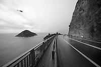 breakaway riders racing alongside the Mediteranian<br /> <br /> 2014 Milano - San Remo