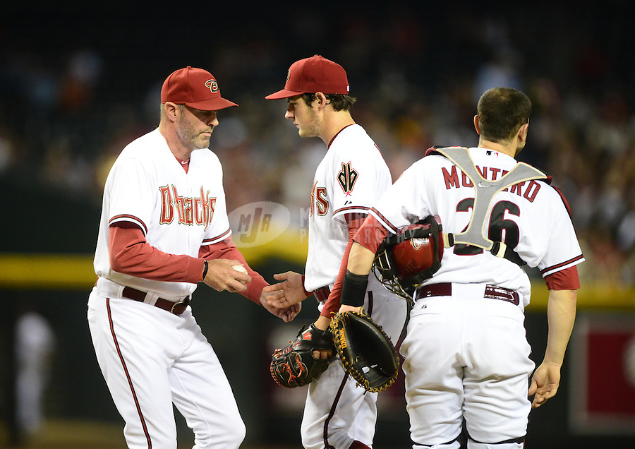 Jul. 3, 2012; Phoenix, AZ, USA: Arizona Diamondbacks pitcher Trevor Bauer (center) gives the ball to manager Kirk Gibson (left) as catcher Miguel Montero looks on against the San Diego Padres at Chase Field. Mandatory Credit: Mark J. Rebilas-