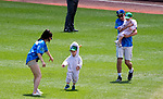 HARTFORD,  CT-071818JS09--Staff assist contestants competing in the &quot;Baby Goat Race&quot; between innings of the Yard Goat's game against Reading on Wednesday afternoon at Dunkin Donuts Park in Hartford.<br /> Jim Shannon Republican American