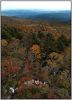 Hikers climb a rocky path at Grandfather Mountain, in North Carolina's Blue Ridge Mountains.