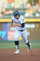 Adam Engel (11) of the Charlotte Knights takes off for third base against the Rochester Red Wings at BB&T BallPark on May 14, 2019 in Charlotte, North Carolina. The Knights defeated the Red Wings 13-7. (Brian Westerholt/Four Seam Images)