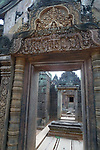 Angkorian temple Banteay Srei (late 10th century) 967.<br /> View through the doorway of Gopura II towards the inner sanctuary.<br /> The central sanctuary and the southern sanctuary were dedicated to Shiva and the northern sanctuary was dedicated to Vishnu.<br /> Banteay Srei temple is situated 20km north of Angkor, built during the reign of Rajendravarman by Yajnavaraha, one of his counsellors. In antiquity Isvarapura was a small city that grew up around the temple. Banteay Srei was dedicated to the worship of Shiva, the foundation stele describes the consecration of the linga Tribhuvanamahesvara (Lord of the three worlds) in 967.