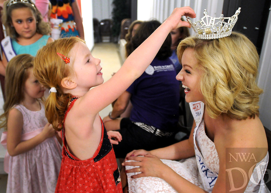 NWA Media/BEN GOFF  @NWABenGoff -- 08/16/14 Emily Horton, 5, of Bentonville, feels the crown of Ashton Yarbrough, 17, of Gravette, 2014 Miss Arkansas Outstanding Teen, as Yarbrough greets participants in the tiny tot age group during the Tiny and Little Miss Benton County pageant at the Benton County Fair near Bentonville on Saturday August 16, 2014.