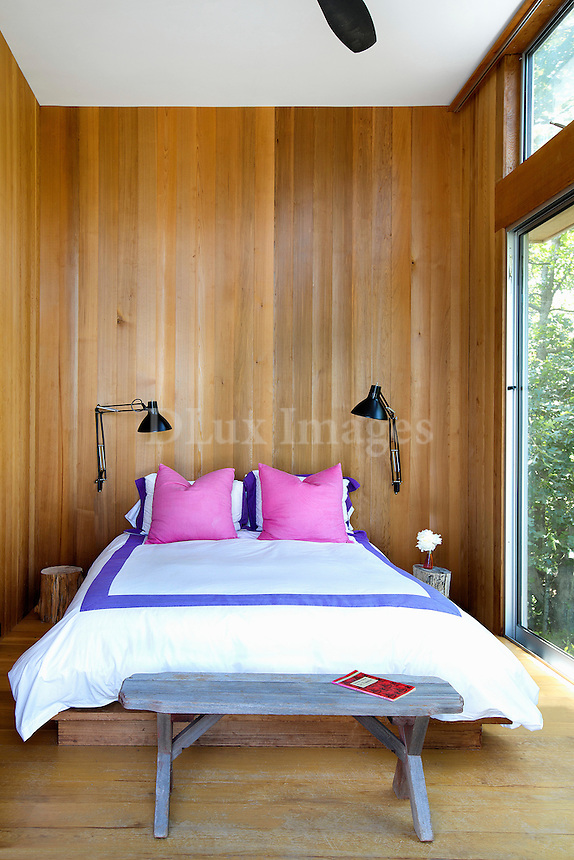 bedroom with wood panelling wall