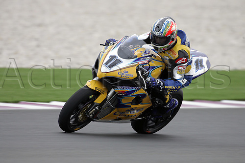 25 February 2005: Australian rider Troy Corser (AUS) on his Alstare Suzuki Corona Extra GSXR100 K5 exits turn six during free practice for round one of the SBK Superbike World Championship held at the Losail International Circuit, Doha, Qatar. Photo: Neil Tingle/Action Plus..050225 motorcycling motorcycle racing bike racing SBK sport motor sports motorsport motorsports