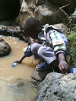In a small village not far from Mt. Kenya, a young boy gathers water from the only real water source he knows: a dirty, seasonal, river.   The riverbanks are laden with livestock urine and feces. Drinking this water causes diseases such as typhoid, brucellosis and malaria.  Although these diseases can be cured through the intake of proper medication, many of the poor who live in this area are unable to afford the medical care. Communities like these benefit innumerably from Matanya's Hope rainwater storage tank donations.