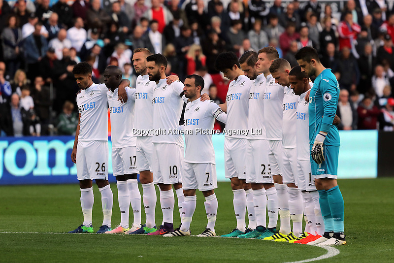 Swansea players observe a minute's silence for the 50th anniversary of the Aberfan disaster prior to the Premier League match between Swansea City and Watford at The Liberty Stadium on October 22, 2016 in Swansea, Wales, UK.