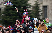 People watch as United States President Donald Trump and First Lady Melania Trump participate in their inaugural parade after being sworn-in as the 45th President in Washington, D.C. on January 20, 2017.    <br /> Credit: Kevin Dietsch / Pool via CNP
