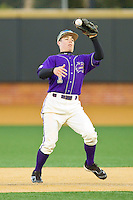 Western Carolina Catamounts second baseman Bradley Strong (1) snow cones the baseball during the game against the Wake Forest Demon Deacons at Wake Forest Baseball Park on March 26, 2013 in Winston-Salem, North Carolina.  The Demon Deacons defeated the Catamounts 3-1.  (Brian Westerholt/Four Seam Images)