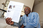 DNA Exonerated prisoner Thomas McGowan, in his home in Garland, Texas, holds a copy of a news article about his release from prison.