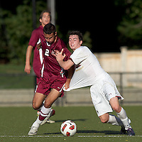 Harvard University forward Michael Innocenzi (2) and Boston College midfielder/defender Conor Fitzpatrick (8) battle for the ball. Boston College defeated Harvard University, 2-0, at Newton Campus Field, October 11, 2011.
