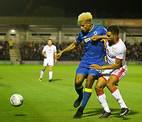 AFC Wimbledon's Lyle Taylor holds off Milton Keynes' Scott Goldbourne during the Sky Bet League 1 match between AFC Wimbledon and MK Dons at the Cherry Red Records Stadium, Kingston, England on 22 September 2017. Photo by Carlton Myrie / PRiME Media Images.