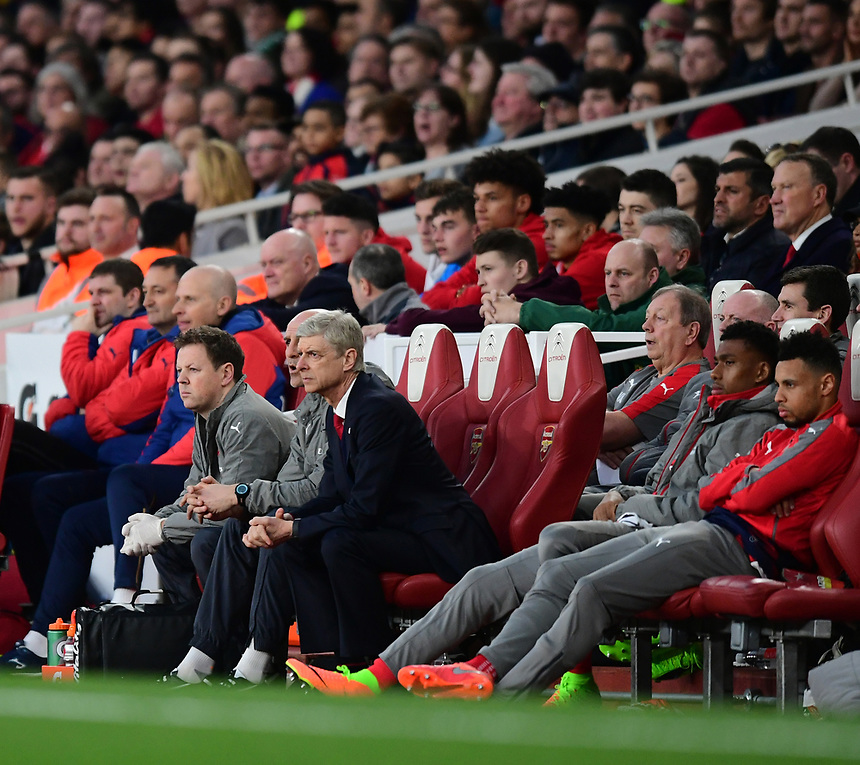 Arsenal manager Arsene Wenger sits in the dug-out<br /> <br /> Photographer Chris Vaughan/CameraSport<br /> <br /> The Emirates FA Cup Quarter-Final - Arsenal v Lincoln City - Saturday 11th March 2017 - The Emirates - London<br />  <br /> World Copyright &copy; 2017 CameraSport. All rights reserved. 43 Linden Ave. Countesthorpe. Leicester. England. LE8 5PG - Tel: +44 (0) 116 277 4147 - admin@camerasport.com - www.camerasport.com