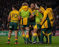 Australia's Israel Folau celebrates scoring his sides first try with team mates<br /> <br /> Photographer Bob Bradford/CameraSport<br /> <br /> 2018 Quilter Internationals - England v Australia - Saturday 24th November 2018 - Twickenham - London<br /> <br /> World Copyright &copy; 2018 CameraSport. All rights reserved. 43 Linden Ave. Countesthorpe. Leicester. England. LE8 5PG - Tel: +44 (0) 116 277 4147 - admin@camerasport.com - www.camerasport.com