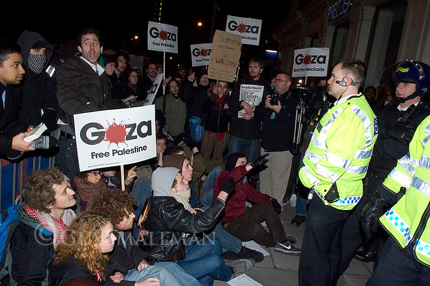 Protesters converge on the London Hillel Student Centre to oppose a meeting being addressed by IDF colonel Geva Rapp. There were scuffles at the door with Police and security guards. One protester scaled the side of the buliding. The main road was blocked for several hours and a few arrests were made. The Police announced that the meeting had been cancelled due to the demonstration.