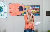 Laurel Cheever '16 talks at the rally. Occidental College students march in a rally organized by Fossil Free Occidental on Nov. 14, 2014. The group hopes to end Oxy's reliance on fossil fuels by freezing all investments in the 200 largest fossil-fuel companies (measured by their proven carbon reserves in oil, gas or coal) and over the next five to ten years sell the stock in these same companies, and then reinvest 5%, at minimum, of the divested portfolio in socially responsible investments. (Photo by Marc Campos, Occidental College Photographer)