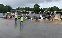Workers with Redline Contractor in Springdale walk Friday, July 31, 2020, as work to demolish the former Marvin's IGA store on 15th Street in south Fayetteville continues. The location closed in 2017 and is being razed. The site will be returned to a green space according to construction staff onsite. Visit nwaonline.com/200801Daily/ for today's photo gallery.<br /> (NWA Democrat-Gazette/Andy Shupe)