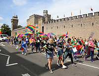 Thousands of people walk past Cardiff Castle as they take part in this year's Pride Parade in the centre of Cardiff, Wales, UK. Sayurday 26 August 2017
