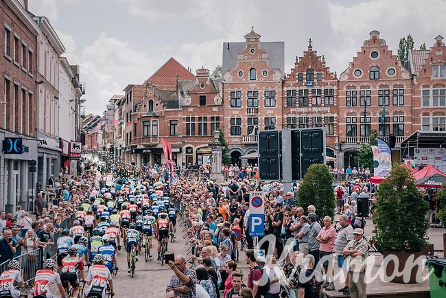 peloton cruising through start town Aarschot for a neutralised parade lap<br /> <br /> 3rd Dwars Door Het hageland 2018 (BEL)<br /> 1 day race:  Aarschot > Diest: 198km