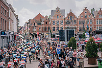 peloton cruising through start town Aarschot for a neutralised parade lap<br /> <br /> 3rd Dwars Door Het hageland 2018 (BEL)<br /> 1 day race:  Aarschot > Diest: 198km