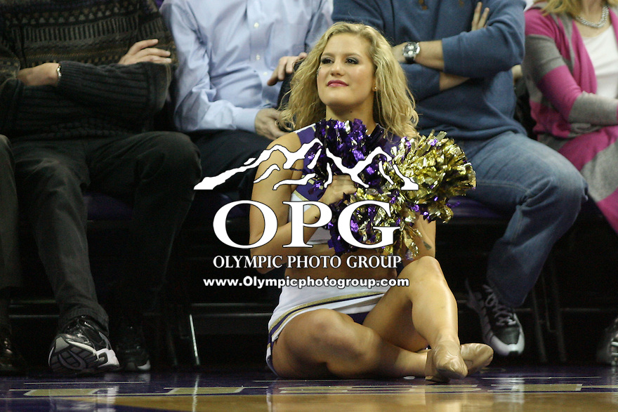 Jan 31, 2013:  Washington cheerleader Hannah Tripp pumped up the crowed during a timeout against Arizona.  Arizona defeated Washington 57-53 at Alaska Airlines Arena Seattle, Washington...
