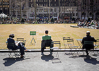 Visitors to Bryant Park in New York City enjoy the late-in-coming spring weather on Tuesday, April 1, 2014.  Temperatures are expected to rise into the upper 50's today.  (© Richard B. Levine)