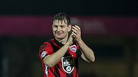 Adam Dugdale of Morecambe celebrates his teams win during the Sky Bet League 2 match between Wycombe Wanderers and Morecambe at Adams Park, High Wycombe, England on 2 January 2016. Photo by Andy Rowland / PRiME Media Images