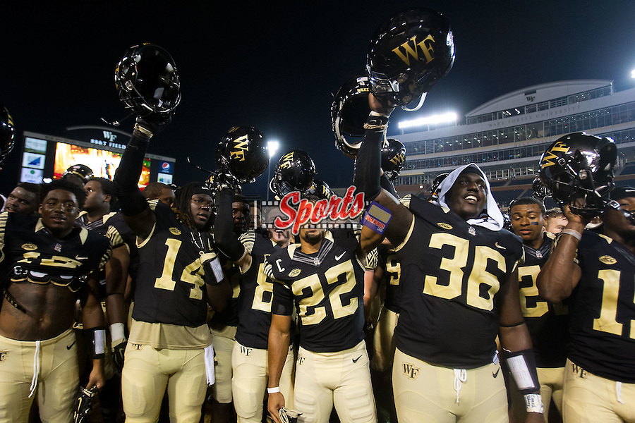 The Wake Forest Demon Deacons salute the student section following their victory over the Elon Phoenix at BB&T Field on September 3, 2015 in Winston-Salem, North Carolina.  The Demon Deacons defeated the Elon Phoenix 41-3.   (Brian Westerholt/Sports On Film)